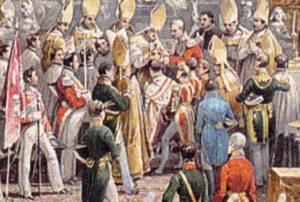 Korunovace Ferdinanda V. ve svatovítské katedrále 7. září 1836 - všimněme si, že korunovaný panovník nemá předpisově jáhenskou štolu, pouze má šerpu, jenže nikoli z levého, ale z pravého ramene!